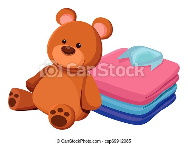 teddy bear toy and folded clothes - csp69912085