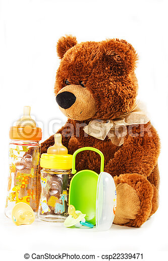 teddy bears and baby bottles and pacifiers for a child - csp22339471