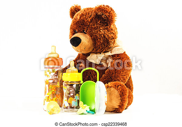 teddy bears and baby bottles and pacifiers for a child - csp22339468