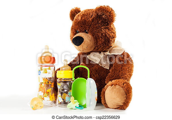 teddy bears and baby bottles and pacifiers for a child - csp22356629
