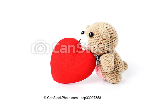 Teddy bears doll kiss red heart shaped Isolated on white background - csp33927858
