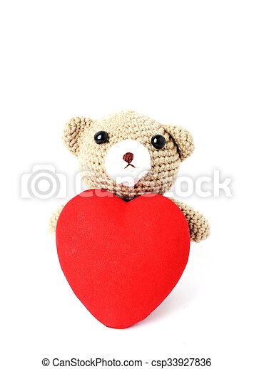 Teddy bears doll with red heart shaped Isolated on white backgrounds vertical side - csp33927836