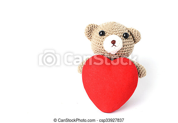 Teddy bears doll with red heart shaped Isolated on white backgrounds - csp33927837
