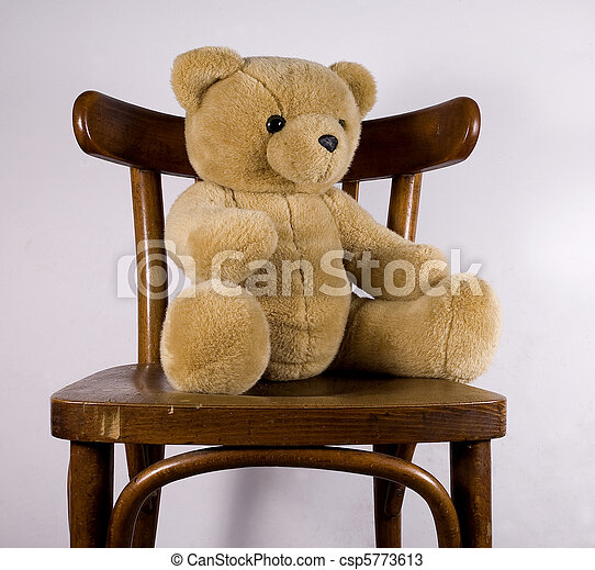 teddy the toy of a teddy bear sitting on a chair. Black Bedroom Furniture Sets. Home Design Ideas