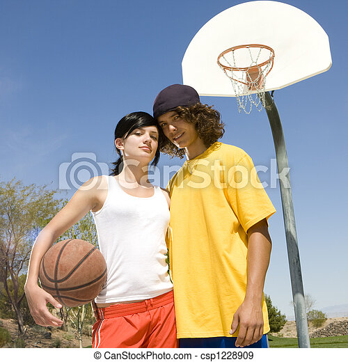 Teen Basketball Couple Hangs Out At A Park S Court