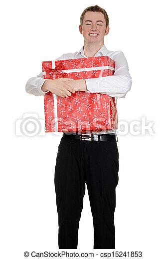 teen boy hugging christmas present - csp15241853