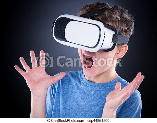 ea613d1d2782 Teen boy in vr glasses. Amazed teen boy screaming