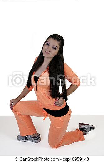 Teen Girl in Orange Exercise Outfit Kneeling - csp10959148