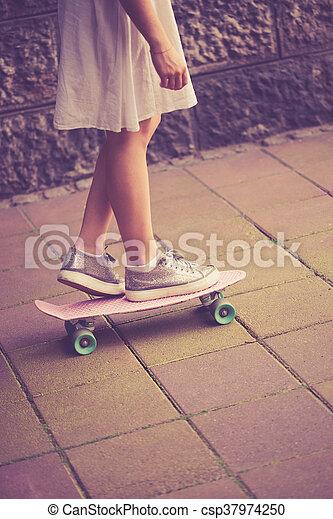 teen girl on skate - csp37974250
