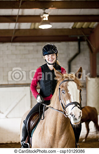 Teen girl riding horse - csp10129386