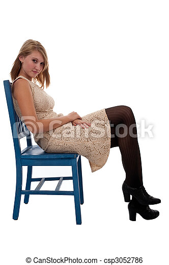 Teen Girl Sitting In A Blue Chair   Csp3052786