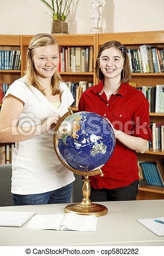 Teen Girls in Library with Globe - csp5802282