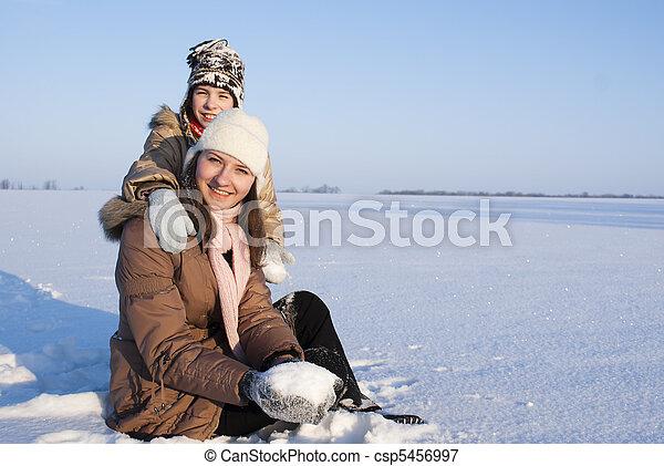 Teen Girls Sitting In Snow Csp