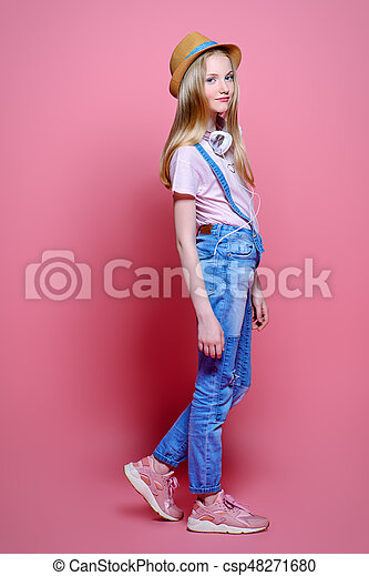 9c70200947817 Teen in jeans and hat. Teen s fashion. cute girl teenager wearing ...