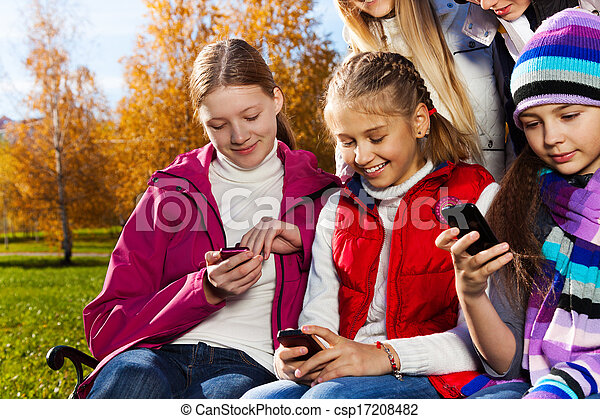 Teen kids busy with cell phones - csp17208482