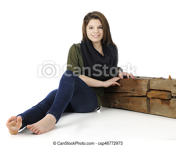 Teen Girl Leaning Against Tree With Backpack Stock Photo