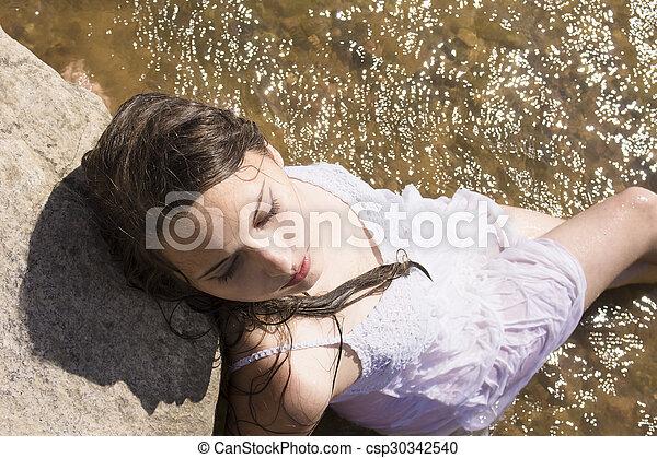 Teen mermaid girl in the lake - csp30342540