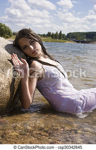 Teen mermaid girl in the lake - csp30342645