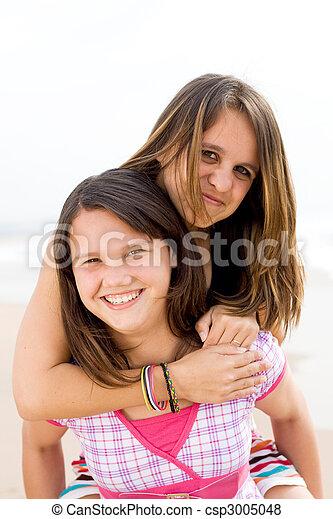 teen piggyback - csp3005048