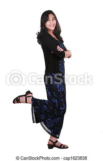 Teenage girl in elegant dress standing - csp1623838
