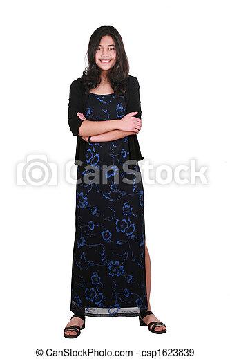 Teenage girl in elegant dress standing - csp1623839