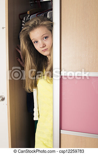 teenage girl in wardrobe at home - csp12259783