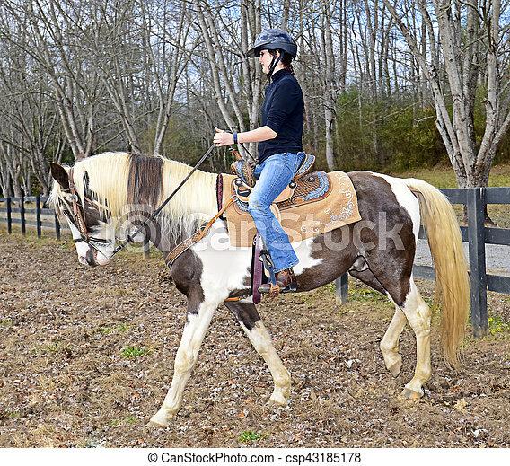 Teenage Girl Riding a Horse - csp43185178