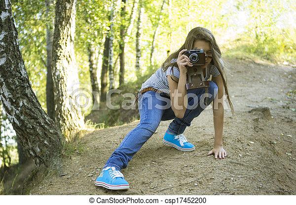 teenage girl  shoting  in the park - csp17452200