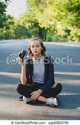 Teenage girl with photo camera - csp40924740