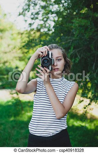 Teenage girl with retro camera - csp40918328