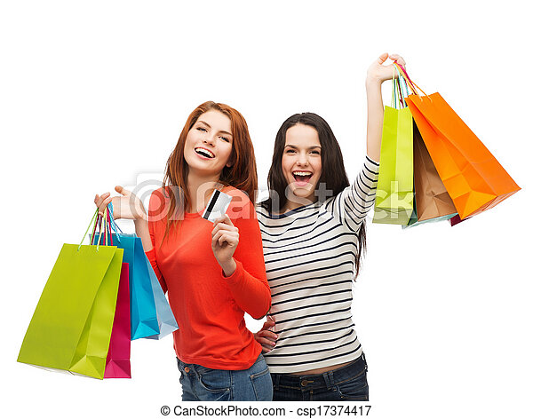 teenage girls with shopping bags and credit card - csp17374417