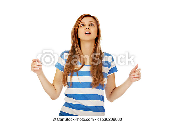Teenage woman with outstretched arms looking up - csp36209080