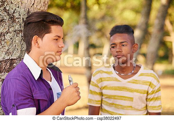 Teenager Boy Smoking E-cig Electronic Cigarette - csp38022497