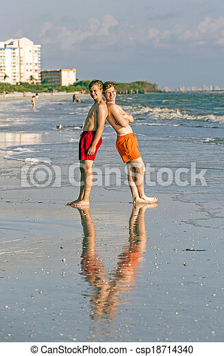 teenager enjoy the sunset at the beach - csp18714340