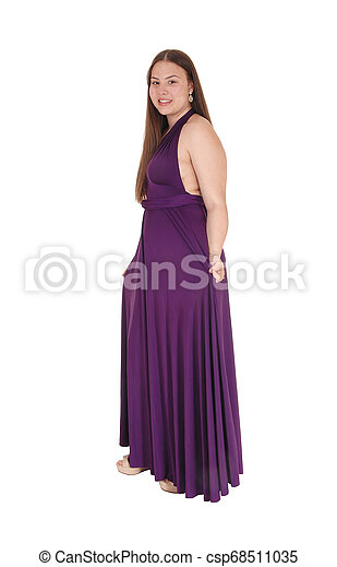 Teenager girl standing in her prom dress - csp68511035