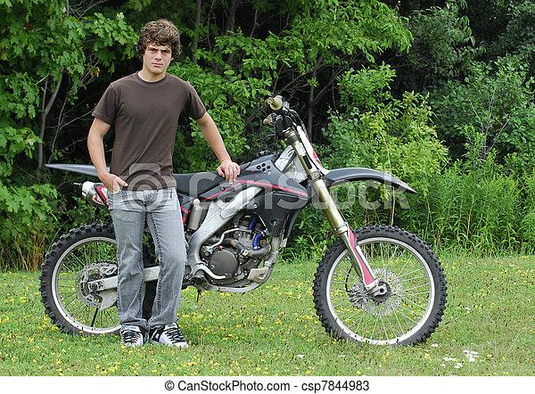 teenager with dirt bike - csp7844983