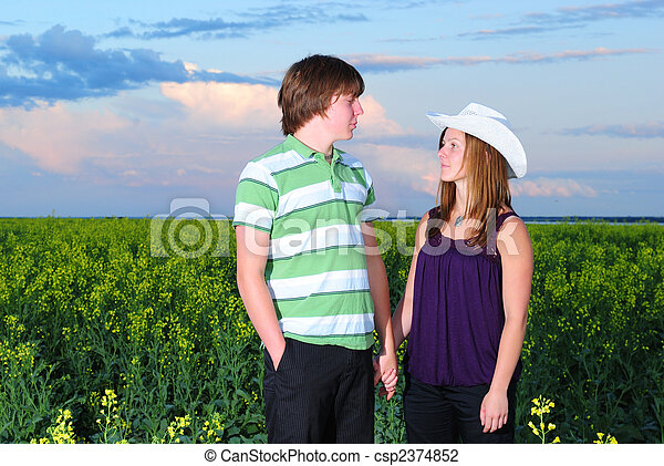 Teenagers in Canola Field - csp2374852