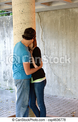 Teenagers snogging