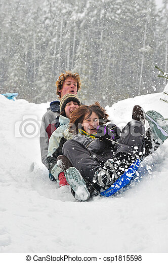 Teens sledding on a saucer - csp1815598