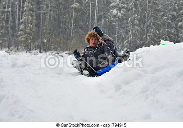 Teens sledding on a saucer - csp1794915