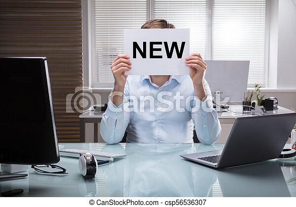 tekst, zakenman, plakkaat, vasthouden, nieuw - csp56536307