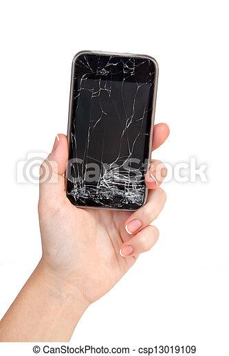 Un teléfono roto en una mano de mujer - csp13019109