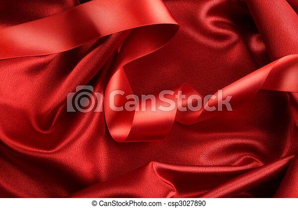 Una tela de satén rojo con cinta - csp3027890