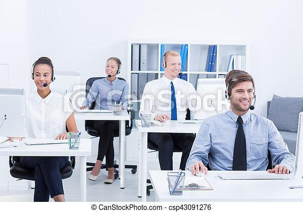 Telemarketers at work - csp43091276