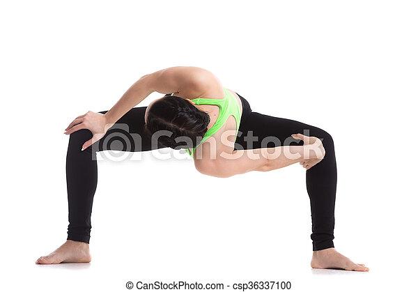temple twist yoga pose sporty girl doing sumo squat