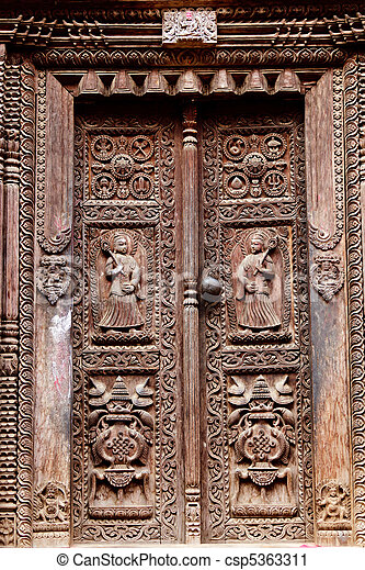 Hindu temple wooden carved door, bhaktapur, nepal.