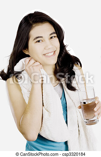 Tenage girl drinking water while wiping off sweat - csp3320184
