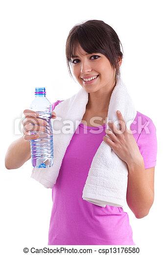 Una joven caucásica sosteniendo una botella de agua - csp13176580