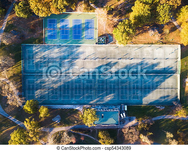 Tennis courts in a park aerial view - csp54343089