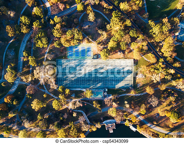 Tennis courts in a park aerial view - csp54343099